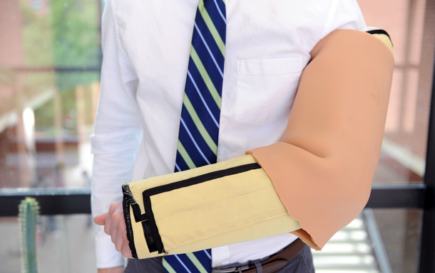 Person standing with canine bite sleeve on arm