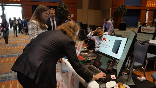 Inventor demonstrating technology at conference