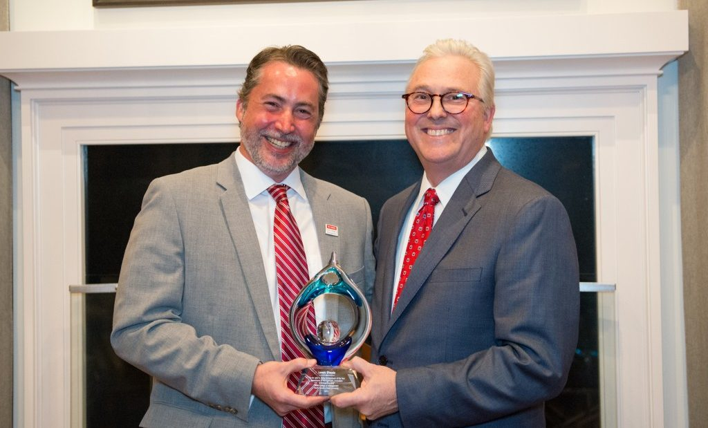 University Chancellor standing with award winner