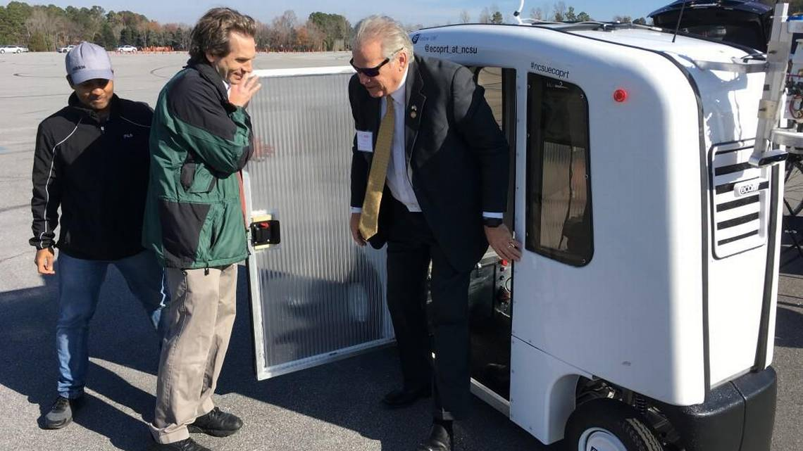 Legislator stepping out of autonomous vehicle