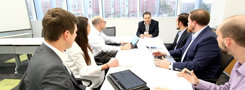 Investor team meeting around table