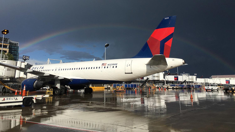 rainbow over Delta airplane