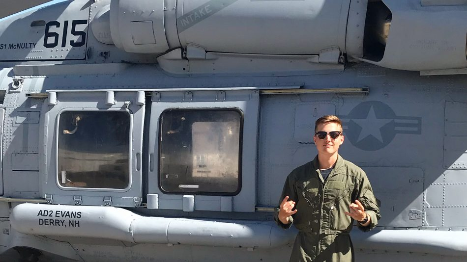 Garret Welso in front of helicopter