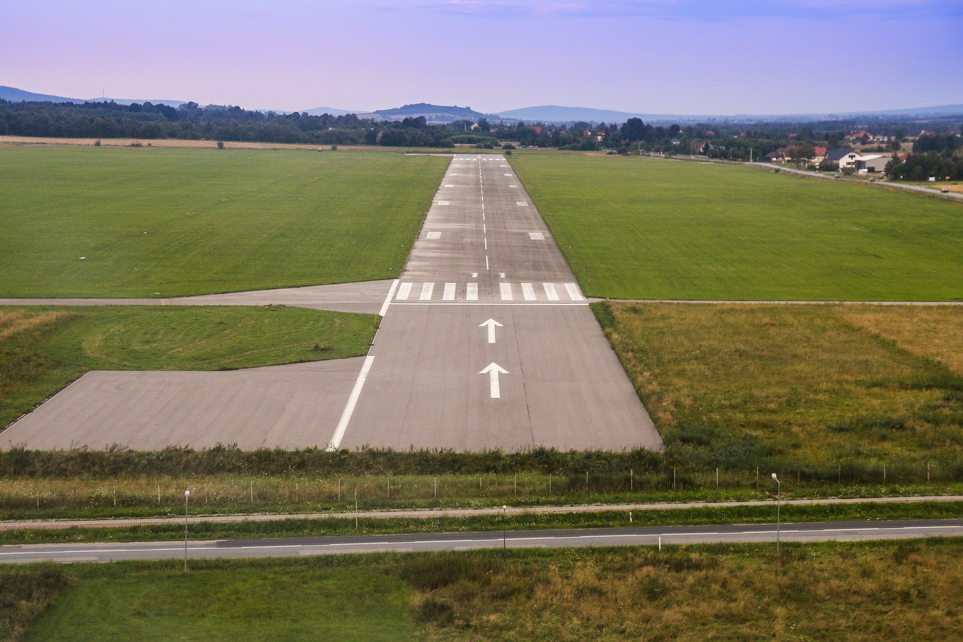 A small-airport runway in a rural mountain town
