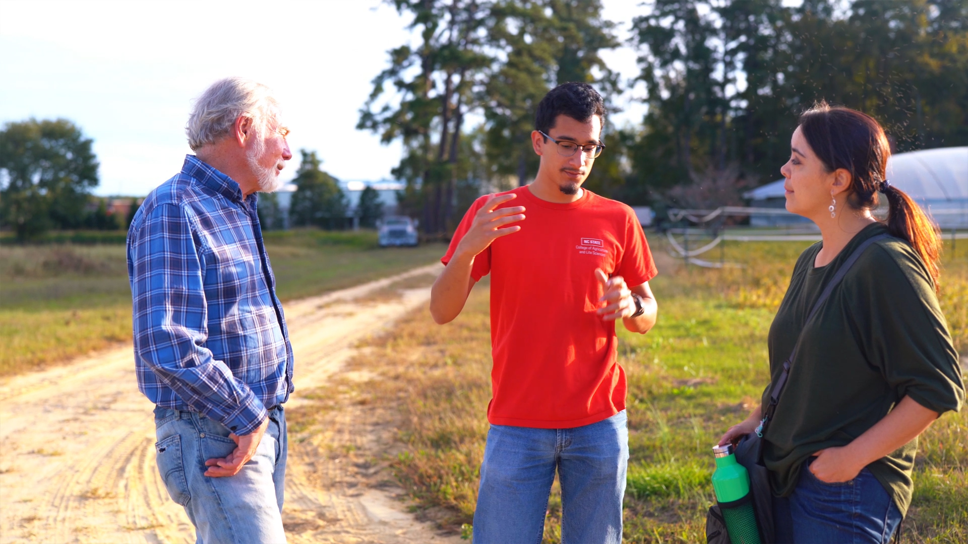 Patti Mulligan, Fred Gould and an NC State student at an AgBioFEWS field site