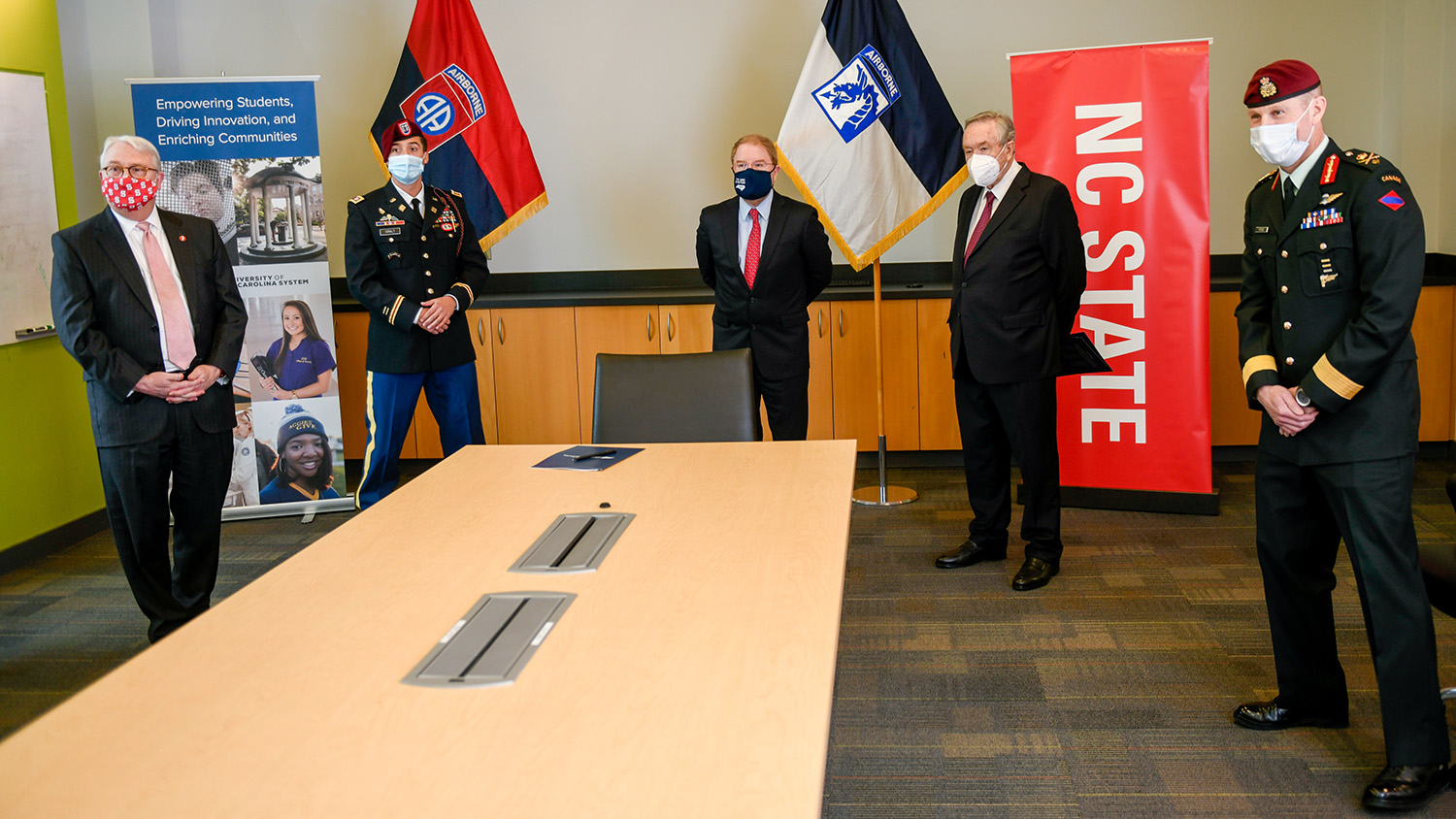 Brig. Gen. Bob Ritchie, UNC System President Peter Hans, NC State University Chancellor Randy Woodson, Vice Chancellor Mladen Vouk and Capt. Dave Giralt attend a signing event to formalize an educational partnership agreement.