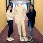 College of Textiles students Ashley Maurice and Ngoc Nguyen display mannequin wearing Protegete, a line of protective clothing for migrant workers in tobacco fields