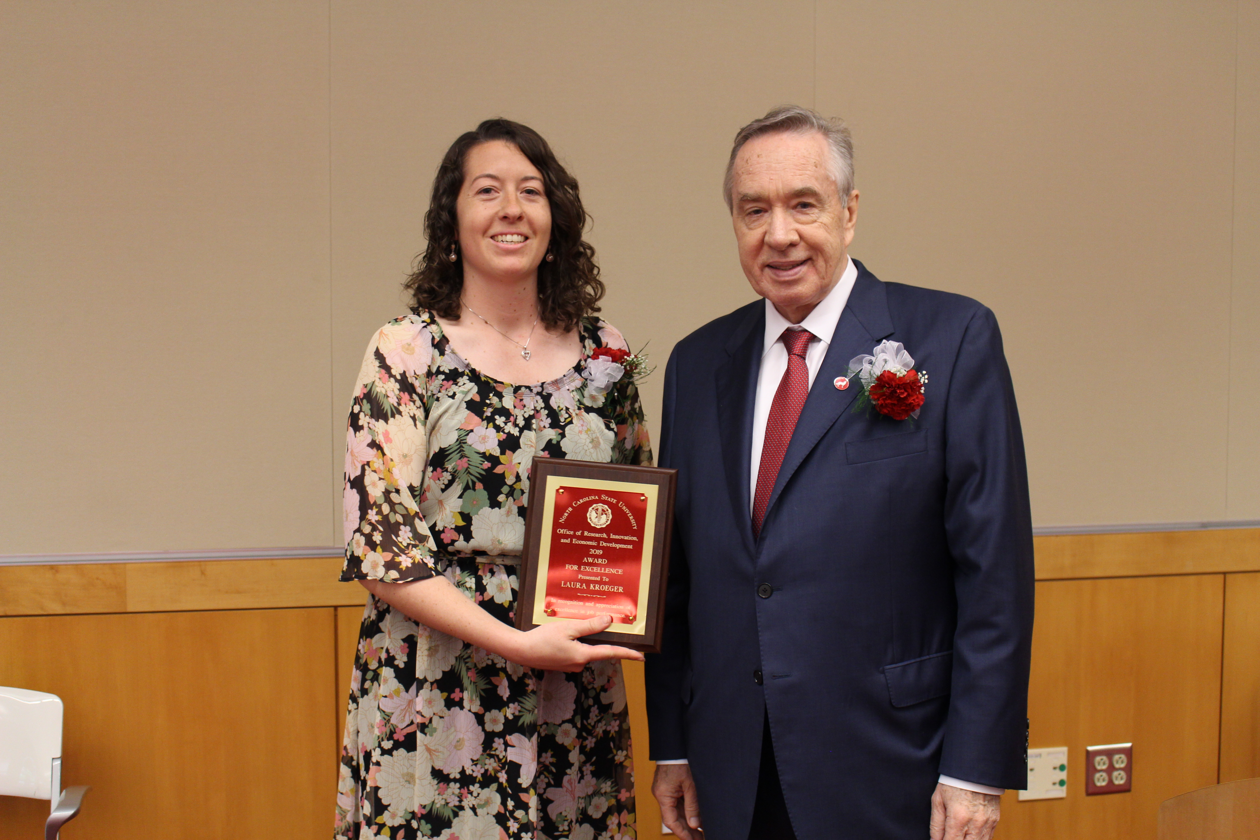 Research Program Specialist Laura Kroeger poses with Vice Chancellor Mladen Vouk after accepting the 2019 ORI Award for Excellence (SHRA)