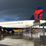 rainbow over Delta airplane